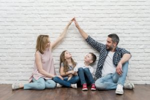Family holding arms up | Life Insurance | Nook Mortgages