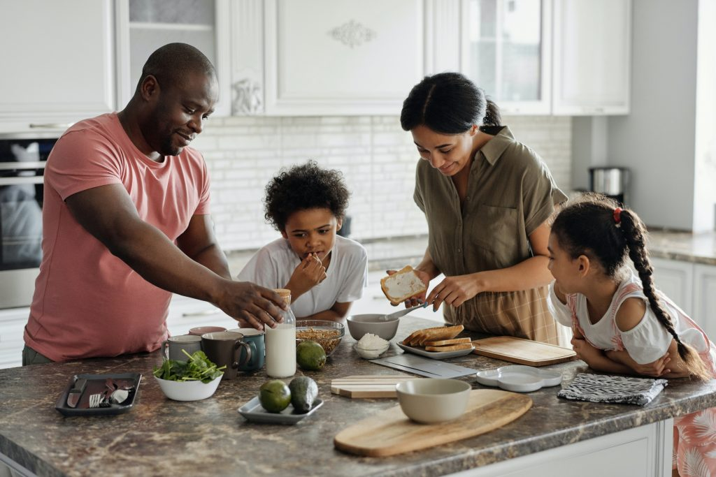 Family in kitchen   RIgh tto buy mortgage   Nook Mortgages
